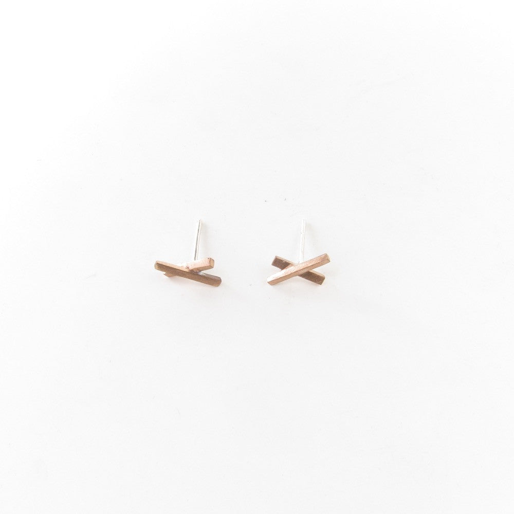 Pick Up Sticks studs in bronze