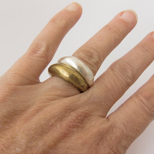 Organic tapered ring in brass and silver by Savage Jewellery