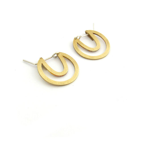 Designer disk earring, cutout in brass by Savage Jewellery made in Durban, South Africa