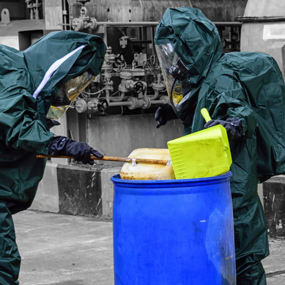 Hazardous clean up with mariners in hazmat suits