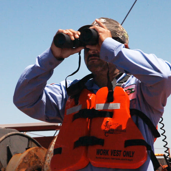 Mariner with binoculars on watch