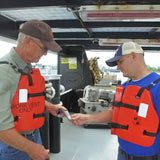Crewmember checking visitor's credentials before a visitor orientation