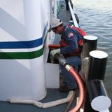 Fuel transfer with the person in charge in personal protective equipment