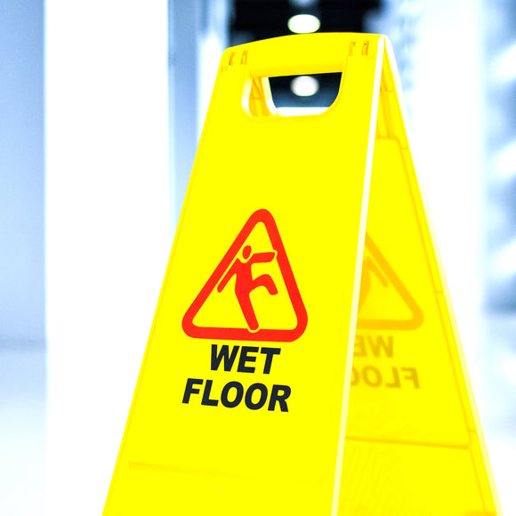 wet floor sign in a maritime galley