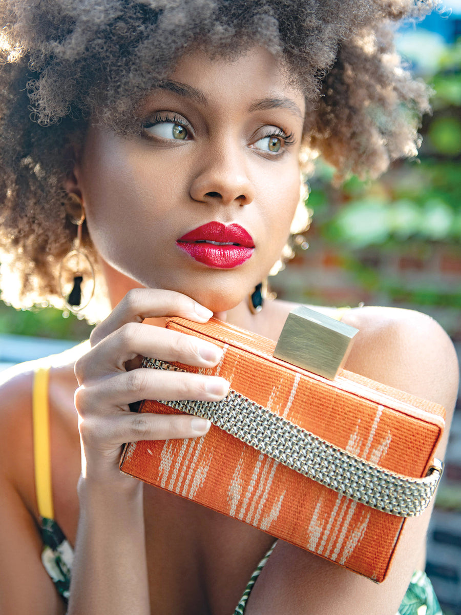 Releve Fashion Clare Hynes Orange Alice Clutch Ethical Designers Sustainable Fashion Brands Purchase with Purpose Shop for Good