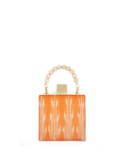 Releve Fashion Clare Hynes Orange Meghan Bag Ethical Designers Sustainable Fashion Brands Purchase with Purpose Shop for Good