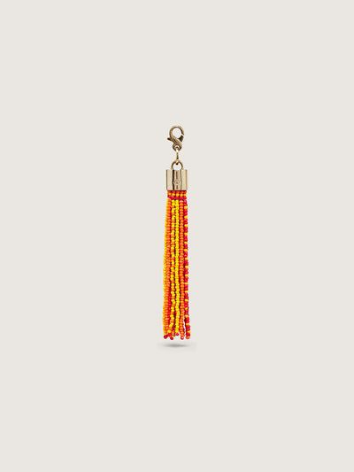 Releve Fashion Okapi Clip On Beaded Tassel Bag Charm Red Yellow Orange Sustainable Ethical Fashion Brand Positive Luxury Positive Fashion Purchase with Purpose Shop for Good