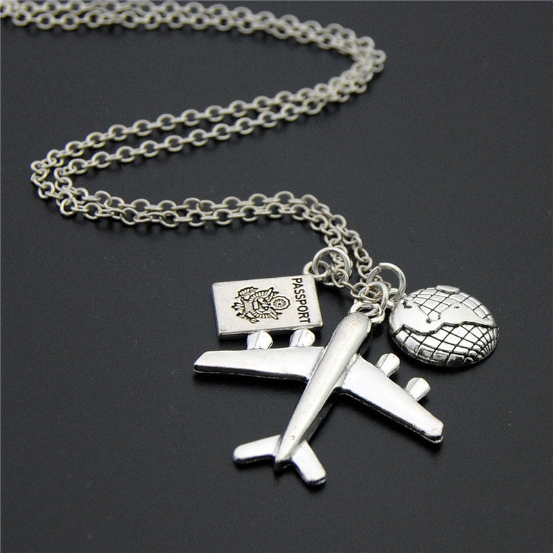 Necklace: Wanderlust Silver Pendant with Travel Charms - Passport, Earth, Airplane