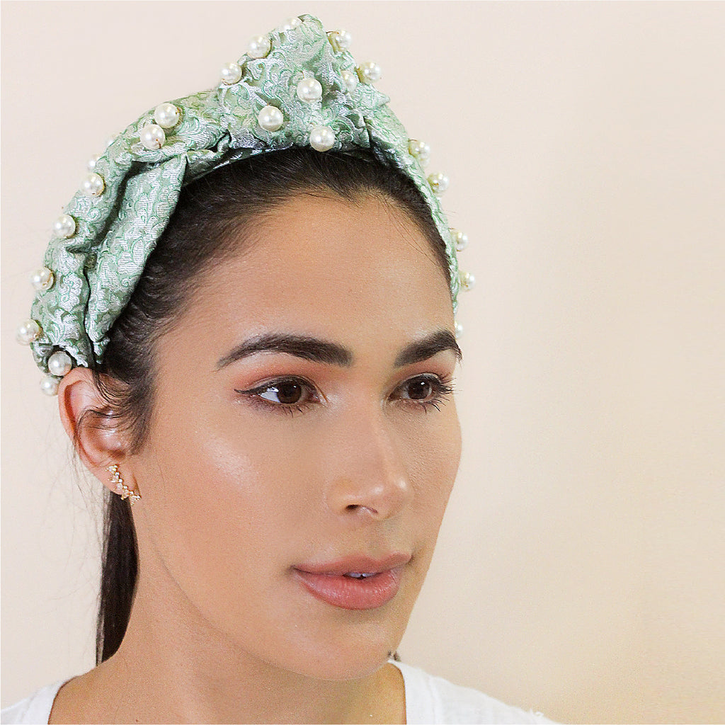 Bad hair day? We've got you covered. Pop on this stunning jacquard head band and you're good to go. Crafted from excess material from our design studio, it's finished with faux pearls.