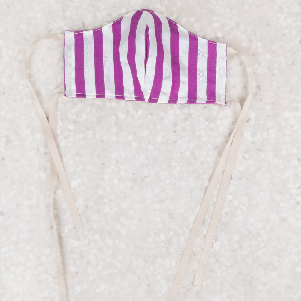 Wear a face mask, but make it cute. You'll love the candy stripe design, silky-poly ribbon ties crafted 100% from leftover material from the Paloma maxi dress of the same print- it arrives with one filter.