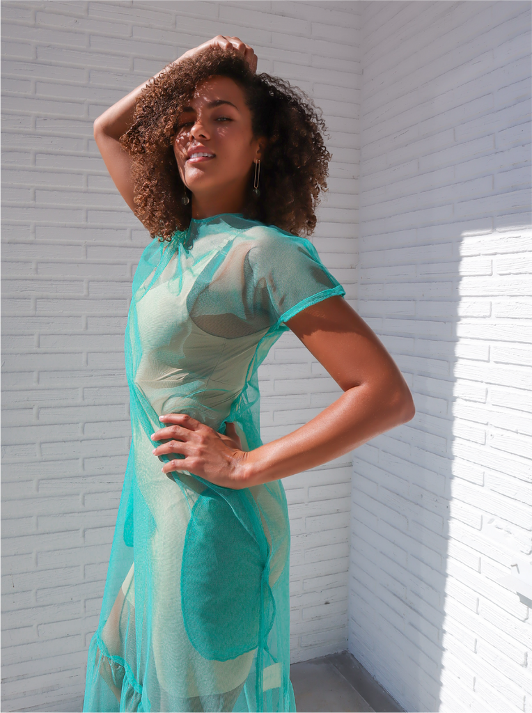 Dress it up or dress it down. This organza dress evokes the ethereal with its lightweight fabric and aqua green hue. The best part, though? It has pockets in this relaxed-fit dress. Sustainable and Ethical Production Model fits: XS-SM 100% Upcycled Tulle Handmade in Miami