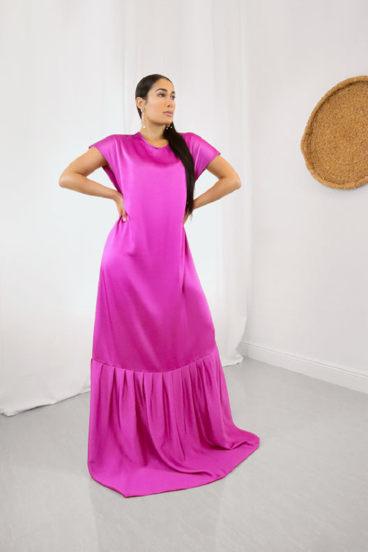 Only two made. Want to slip into a glamorous scene-steeler? This satin finish floor-length dress packs a punch with its bold magenta shade, while the draped fabric below the extreme drop-waist gives it an elegant train.  Fits Small-Large  100% Upcycled Polyester  Handmade in Miami