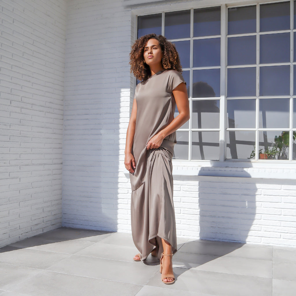 Only two made. This relaxed-fit, elegant maxi dress is cast in a versatile taupe shade and has been ethically made using upcycled material. Name a better way to look stylish and sustainable - we'll wait.  Model fits: XS-SM  100% Upcycled Satin Polyester  Handmade in Miami