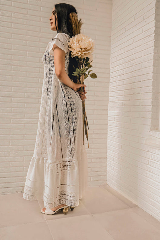 Only two made. You'll look like you were sent from heaven in this macrame lace maxi dress, in angelic off-white. Relaxed, flowy, and floor-length, pair with chunky sandals or trainers for a laid-back look.  Model fit: XS-SM  100% Upcycled Macrame Lace  Handmade in Miami