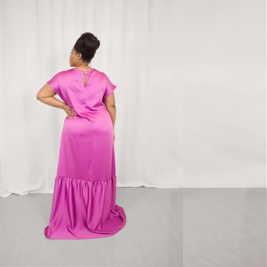 Curvy Size 1X Curvy Size 1X Only three made. Want to slip into a glamorous scene-steeler? Our satin-crepe figure-flattering, floor-length gown packs a punch with its bold magenta shade. Beautifully swaying from head to toe, the draped fabric plunges into an extreme drop-waist with an elegant train.  Model fit: 1X Curvy  100% Upcycled Crepe Polyester  Handmade in Miami