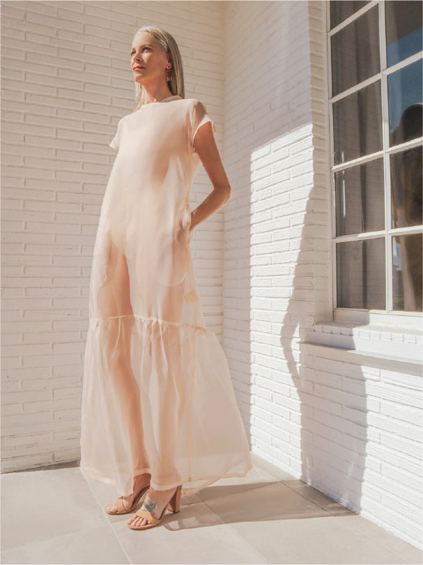 Only one made. Completely one-of-a-kind, this organza dress evokes the ethereal with its lightweight fabric and blush ink hue. The best part, though? It has pockets in this relaxed-fit dress. Sustainable and Ethical Production Model fits: XS-SM 100% Upcycled Tulle Handmade in Miami