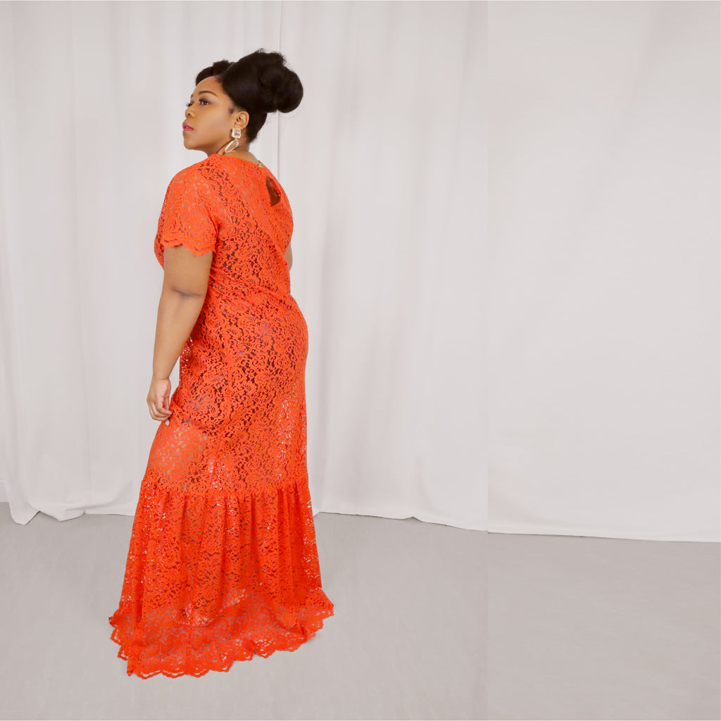 The scalloped sleeves and hem give this floor-length dress a feminine touch, while the vibrant orange shade keeps it bold and bright.   Model fit: 1X Curvy  100% Upcycled Lace  Handmade in Miami