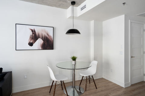 eiffel chairs with glass table in contemporary condo design