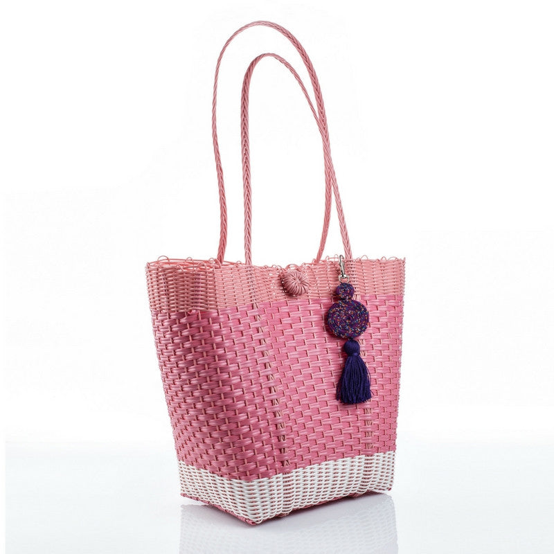 Eco-friendly white and pink recycled plastic handbag with a purple tassel, handmade by artisans in Guatemala. Ecofashion, green fashion, sustainable fashion