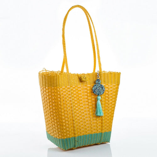 Eco-friendly yellow and turquoise recycled plastic handbag with a turquoise tassel, handmade by artisans in Guatemala perfect for a beach bag or picking up vegetables at the market. Ecofashion, green fashion, sustainable fashion