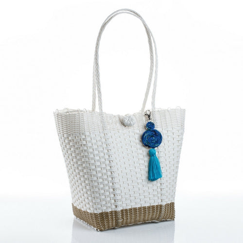 Eco-friendly white and gold recycled plastic handbag with a blue tassel, handmade by artisans in Guatemala perfect for a beach bag or picking up vegetables at the market. Ecofashion, green fashion, sustainable fashion