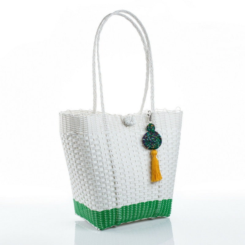 Eco-friendly white and green recycled plastic handbag with a yellow tassel, handmade by artisans in Guatemala. Ecofashion, green fashion, sustainable fashion