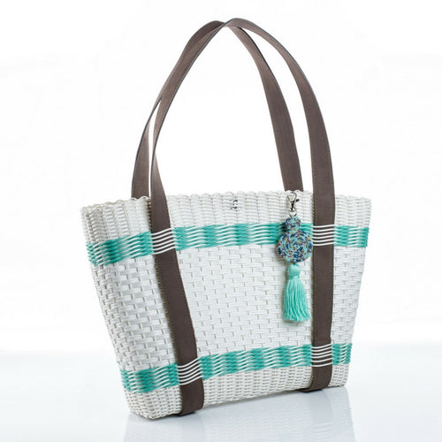 Eco-friendly and vegan-friendly white and turquoise recycled plastic handbag with a turquoise tassel, handmade by artisans in Guatemala perfect for a beach bag or everyday wear. Green fashion, save the environment, sustainable fashion.