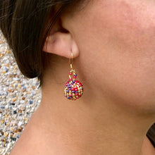 Guatemalan handmade beaded jewelry, made by artisans, fair trade, empowering women, made by indigenous women, one of a kind earrings, fashion jewelry, gold, pink and purple beads.