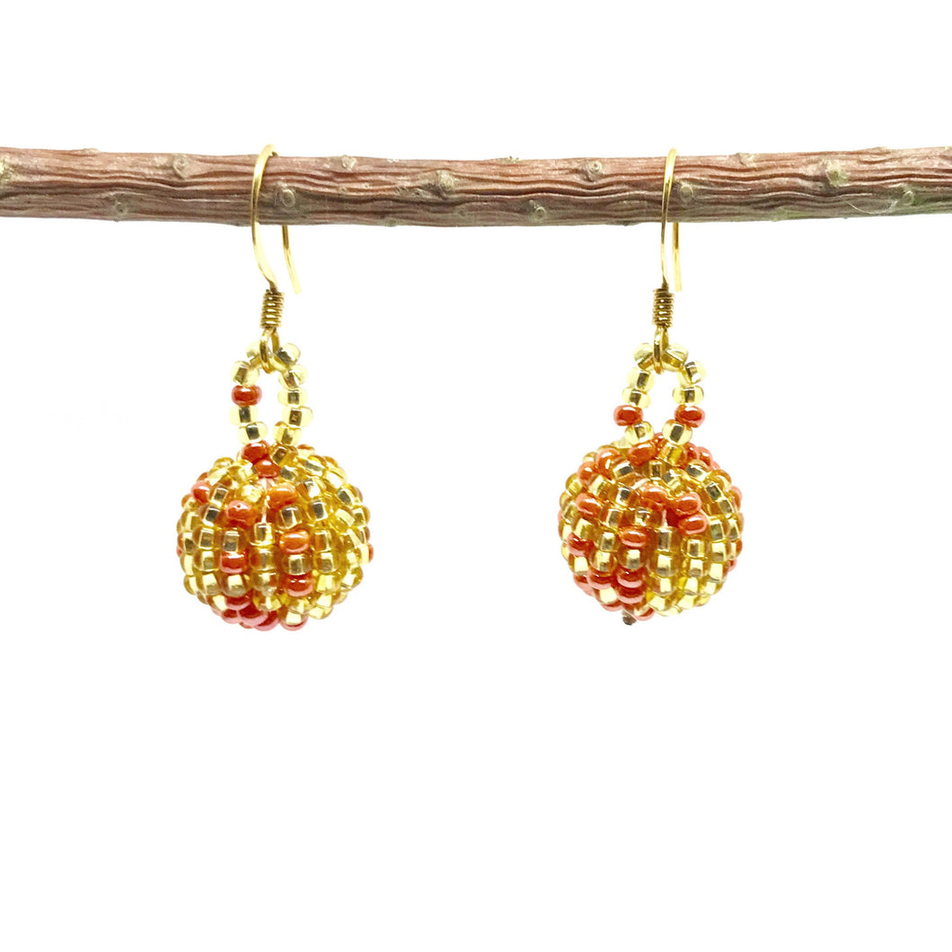 Guatemalan handmade beaded jewelry, made by artisans, fair trade, empowering women, made by indigenous women, one of a kind earrings, fashion jewelry, gold and pink beads.