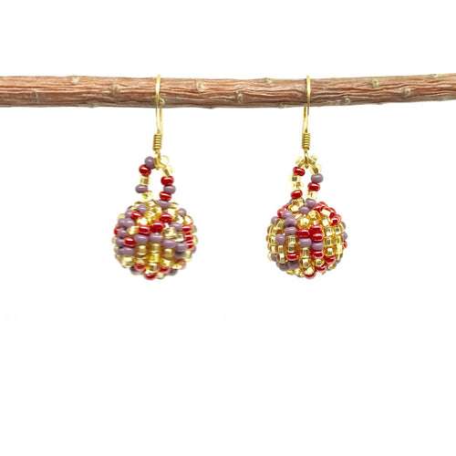 Guatemalan handmade beaded jewelry, made by artisans, fair trade, empowering women, made by indigenous women, one of a kind earrings, fashion jewelry, gold, purple and pink beads.