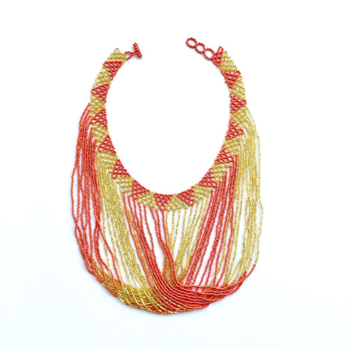 Handmade beaded necklace made by indigenous communities in the highlands of Guatemala, combining gold and pink colored glass beads. Fair trade, handmade, beaded jewelry, unique, artisan made.