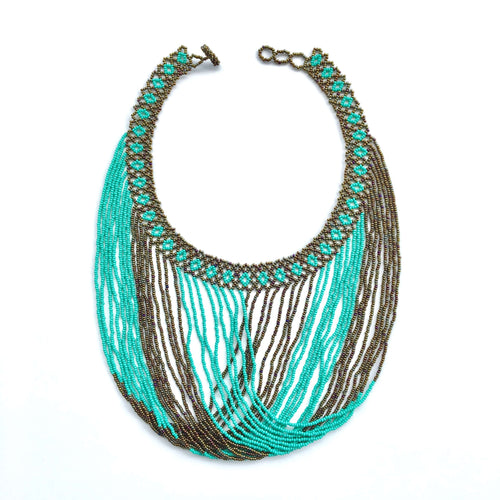 Handmade beaded necklace made by indigenous communities in the highlands of Guatemala, combining bronze and turquoise colored glass beads. Fair trade, handmade, beaded jewelry, unique, artisan made.