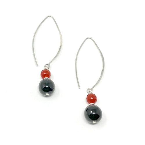 Fine jewelry, Dangling sterling silver earrings with black jadeite jade handcrafted in Guatemala combined with red carnelian. Fair trade, supporting artisans.
