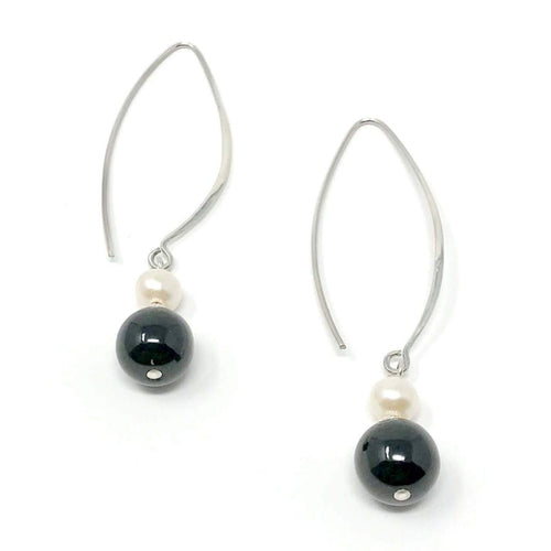 Dangling sterling silver earrings with black jadeite jade handcrafted in Guatemala combined with white natural pearls. Fair trade, supporting artisans.