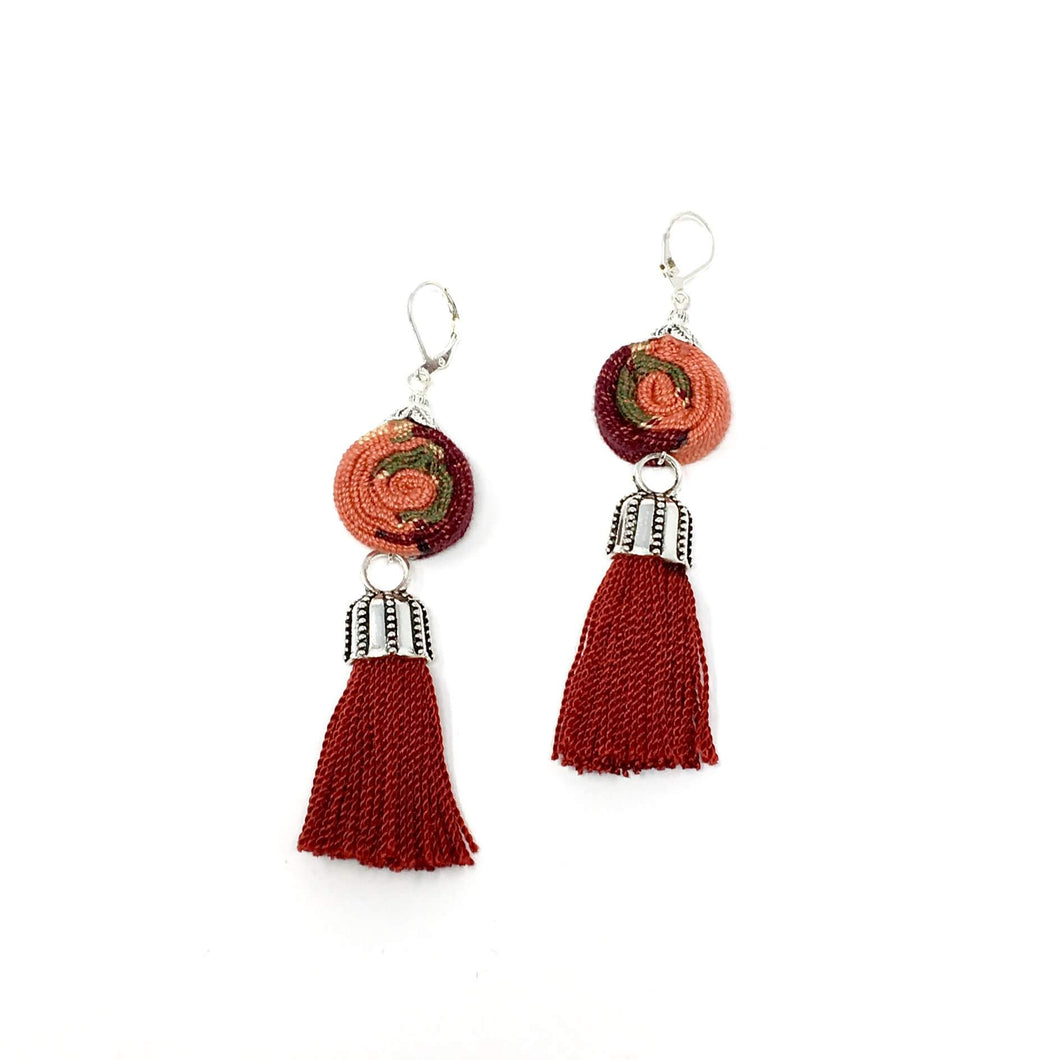 Sweet handmade earrings with Guatemalan textile and tassel in dark red