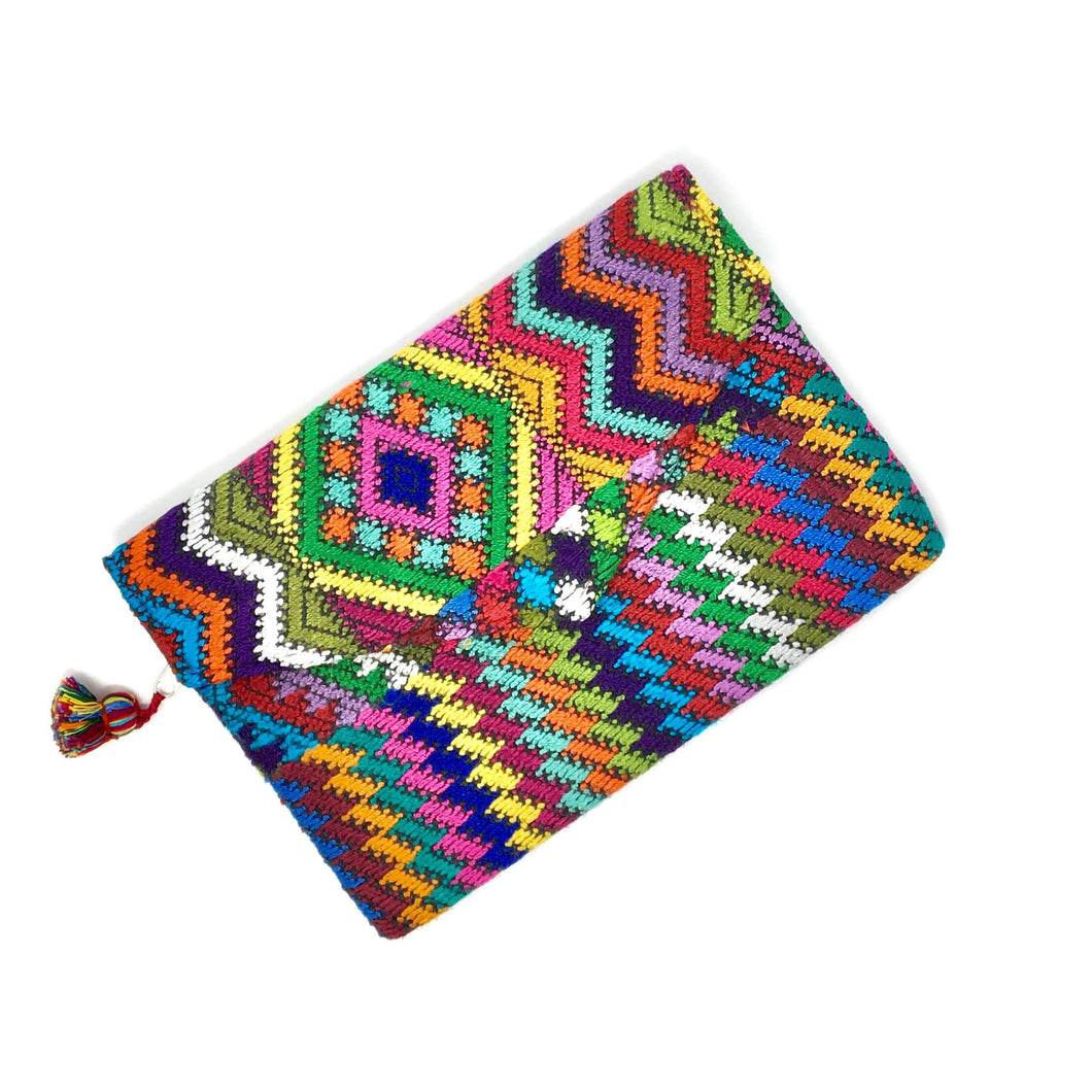 One of a kind handmade clutch with upcycled Mayan fabric, artisan made in Guatemala, ethically made, fair trade. Colorful fabric clutch, handcrafted, handwoven.