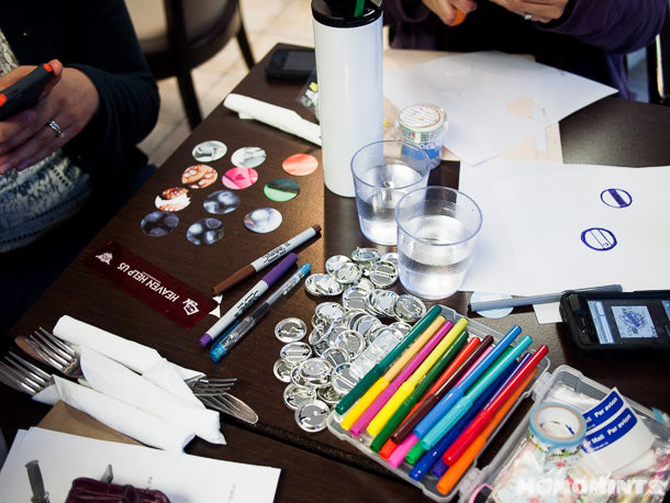 Our crafty mess making buttons at our craft meet-up in Vancouver