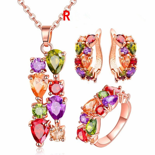 Rose golden ring, earring and necklace set. Zirconia multicolor.