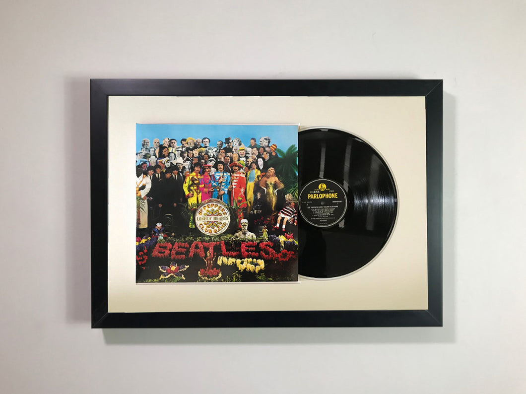 The Beatles- Sgt. pepper's lonely hearts club band Framed 12