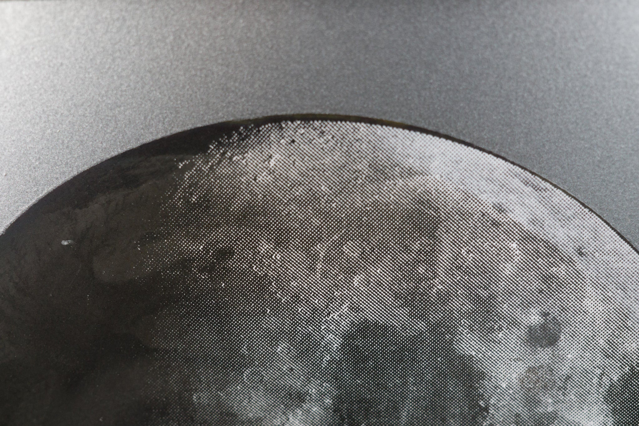 Iridescent Moon on Steel Sheet Metal