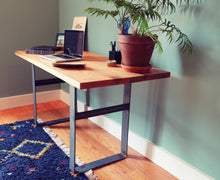 Home office of Workshop-25 Humboldt Writing Desk - 22 inch x 60 inch red oak desktop, with houseplant, laptop, blue Moroccan rug, brown wood, 3 inch wide black and gray steel legs, sturdy design, industrial, minimal furniture style