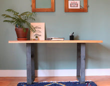 Home office of Workshop-25 Humboldt Writing Desk - 22 inch x 60 inch red oak desktop, with houseplant, folder, blue Moroccan rug, brown wood, 3 inch wide black and gray steel legs, sturdy design, industrial, minimal furniture style