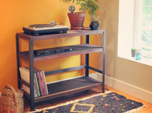 Living room styling of Workshop-25 Roscoe Record Player Table - Industrial reclaimed wood shelf with record player, amp, records, houseplants, baskets, moroccan rug, 3 shelves, roughly 4 feet high, medium width, dark brown mahogany stained wood, black and gray steel, sturdy design