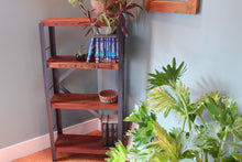 matchbox bookcase by workshop25 - four shelf, tall slim bookcase shown against a teal wall with a white Moroccan rug and a tall green plant