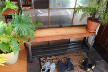 Entryway styling of Workshop-25 Burnham Bench - Industrial reclaimed wood bench with cowboy boots and houseplants, roughly 4 feet long, medium bench height, brown wood, black and gray steel, sturdy design