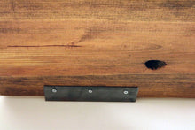 floating shelf on light blue wall - reclaimed wood in a medium brown color - close up shot from beneath shows the hidden steel wall bracket