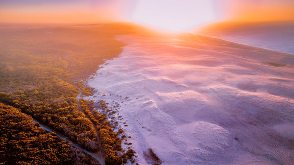 Aerial shot of the sand dunes at sunrise