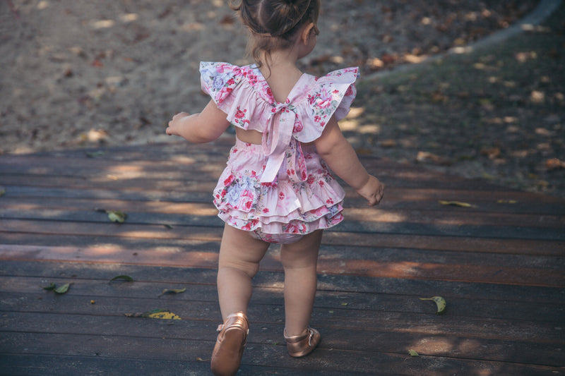 Pink floral romper with matching headband - West & Rose