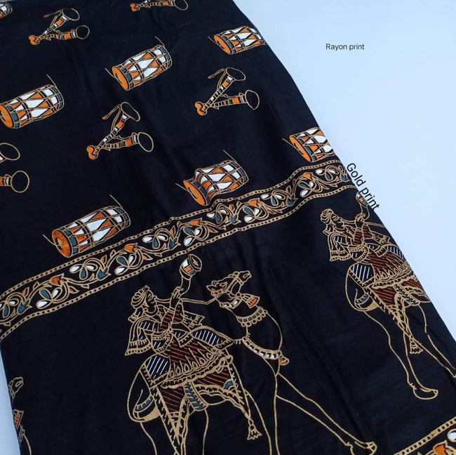 Black Object Print Gold Rayon Fabric