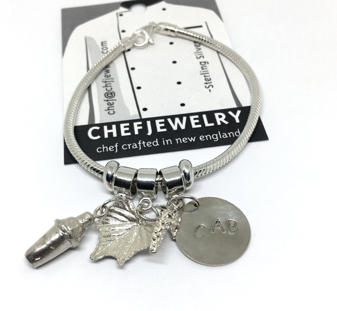 Sterling charm bracelet with cocktail shaker, grape leaves and handstamped charm
